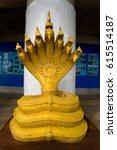 Small photo of Phuket, Thailand, February 1, 2017: Buddhism. Legendary golden seven-headed snake.