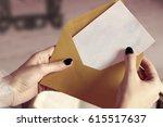 closeup of woman hand opening... | Shutterstock . vector #615517637