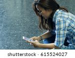 asian woman using smart phone | Shutterstock . vector #615524027