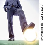 Small photo of business man ready to stomp a ball light