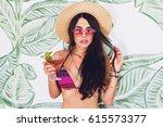 pretty brunette woman in pink...   Shutterstock . vector #615573377