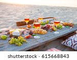 picnic on the beach at sunset... | Shutterstock . vector #615668843