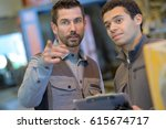 man with clipboard giving... | Shutterstock . vector #615674717