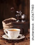 cup of coffee and coffee beans... | Shutterstock . vector #615677483