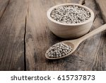 pepper in a bowl on wooden... | Shutterstock . vector #615737873
