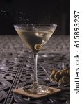 Small photo of Olives Dropping into Martini Glass