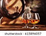 two glass of cognac and old oak ... | Shutterstock . vector #615896057