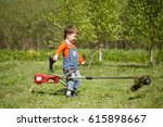 a little boy mows the trimmer... | Shutterstock . vector #615898667