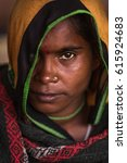 Small photo of Mathura, India - March 14, 2017 : Portrait of unidentified Indian woman with her traditional scarf and piercing during colorful Holi festival.