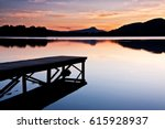 tranquil lake with jetty at... | Shutterstock . vector #615928937