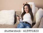 woman watching tv | Shutterstock . vector #615991823