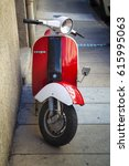 classic scooter vespa parked on ... | Shutterstock . vector #615995063