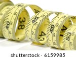 photo of a yellow tape measure  ...   Shutterstock . vector #6159985