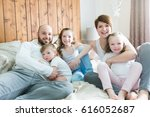 a young happy family of five on ... | Shutterstock . vector #616052687