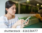 asian woman using smartphone...   Shutterstock . vector #616136477