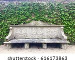 Ornate Stone Bench With Ivy Wall