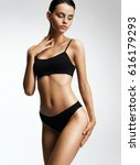 flawless woman in black bikini... | Shutterstock . vector #616179293