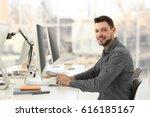 programmer working in office   Shutterstock . vector #616185167