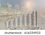 double exposure of coin stacks... | Shutterstock . vector #616254923