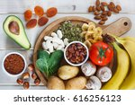 Stock photo potassium food sources as dried apricots raisins avocado cocoa bean pumpkin seeds dried 616256123