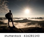 hiker with backpack reaches the ... | Shutterstock . vector #616281143