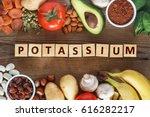 Stock photo potassium food sources as dried apricots raisins avocado cocoa bean pumpkin seeds potatoes 616282217
