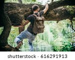 Young Hipster Man Climbing On ...