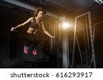 sporty girl blonde jumping over ... | Shutterstock . vector #616293917