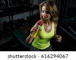 fitness girl blonde drinking... | Shutterstock . vector #616294067