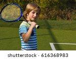 boy standing with tennis racket ... | Shutterstock . vector #616368983