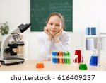 beautiful school girl sitting... | Shutterstock . vector #616409237