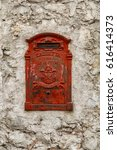 Small photo of Red cast iron mailbox embedded in an ancient wall TRANSLATION: BOX FOR LETTERS, ROYAL MAIL SERVICE