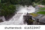 Small photo of Top View Of The Full Force Of Water Overflowing At The Iconic Hinze Dam's Spillway After Cyclone Debbie During The Evening, Advancetown Lake, Gold Coast, Queensland, Australia