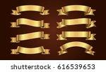 set of golden ribbons on brown... | Shutterstock .eps vector #616539653