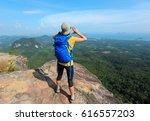 successful woman hiker shouting ... | Shutterstock . vector #616557203