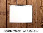 blank notebook on brown rustic... | Shutterstock . vector #616558517