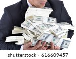 a lot of money in the hands of... | Shutterstock . vector #616609457