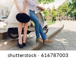 fashionable couple posing on... | Shutterstock . vector #616787003