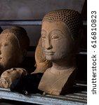 the kitten and buddha statue | Shutterstock . vector #616810823