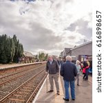 """Small photo of Armathwaite, Cumbria, UK. March 31st 2017. Famous steam train 'The Flying Scotsman"""" travelling through station to mark the re- opening of section of Settle to Carlisle line after 14 months of closure"""