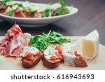 tomato  parmesan    prosciutto... | Shutterstock . vector #616943693