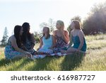 group of girls sitting together ... | Shutterstock . vector #616987727