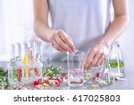 woman mixing perfume samples on ... | Shutterstock . vector #617025803