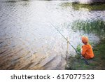 Boy With A Fishing Rod On The...
