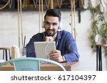 guy with headphones on his head ... | Shutterstock . vector #617104397