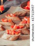 fresh tomato bruschetta | Shutterstock . vector #617113457