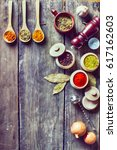 spices and wooden table | Shutterstock . vector #617162603