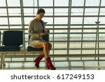 beautiful young woman sits on... | Shutterstock . vector #617249153
