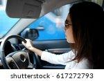 woman driving car  | Shutterstock . vector #617272793