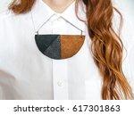 woman wearing a statement...   Shutterstock . vector #617301863